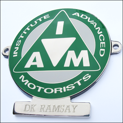 Nickel and enamel (Green) badge engraved R40E
